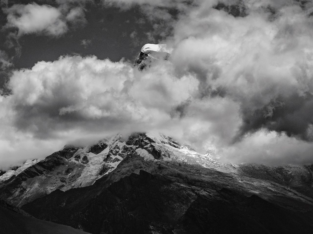 Huascaran (6768m), peeping out of the clouds Huascaran 6768 Meters Cordillera Blanca Peak Clouds Clouds And Sky Highest Mountain Andes Outdoors Scenics Landscape Photography Blackandwhite Ancash Peru Mountain Range Mountain Peak Cordillera De Los Andes Mountain Mania