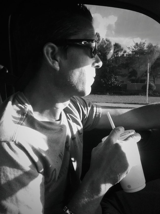 Snapshots Of Life Real People On The Road Man People Of EyeEm People Light And Shadow Blackandwhite Darkness And Light Florida Candid Driving Driver Noir Et Blanc Close-up Outdoors Every Picture Tells A Story
