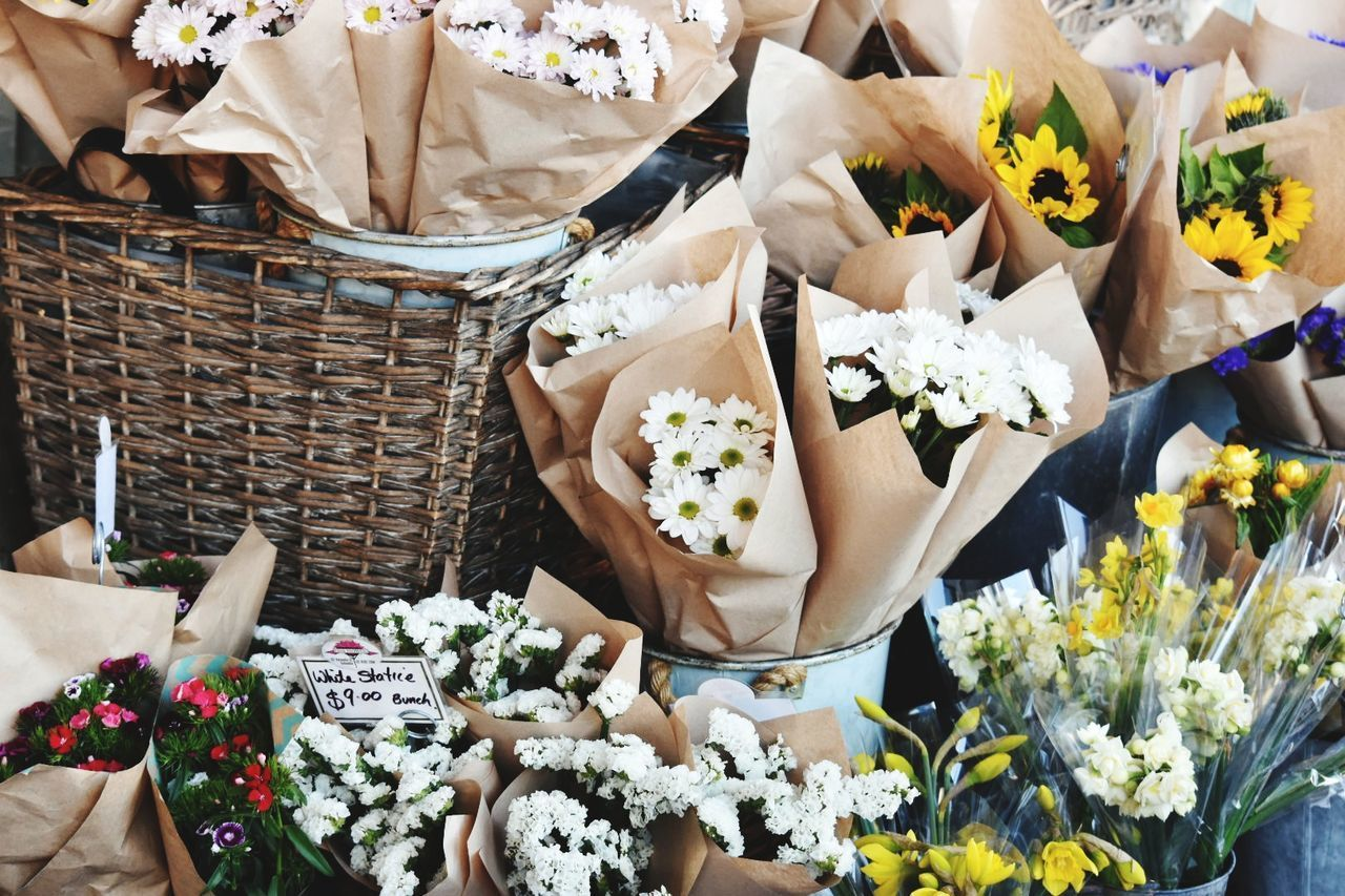 flower, freshness, basket, bouquet, high angle view, variation, food, choice, real people, day, outdoors, fragility, flower market, human body part, one person, close-up, nature, flower head, human hand, people