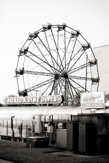 Ferris Wheel from the 1935 World's Fair! Still running in Downtown Fort Smith, AR 1935 Amusement Park Amusement Park Ride Antique Architecture Arkansas Arts Culture And Entertainment Blackandwhite Built Structure Clear Sky Contrast Day Diner Downtown Ferris Wheel Fort Smith No People Outdoors Park At West End Parks And Recreation Sky Text Vintage World's Fair World's Fair San Diego