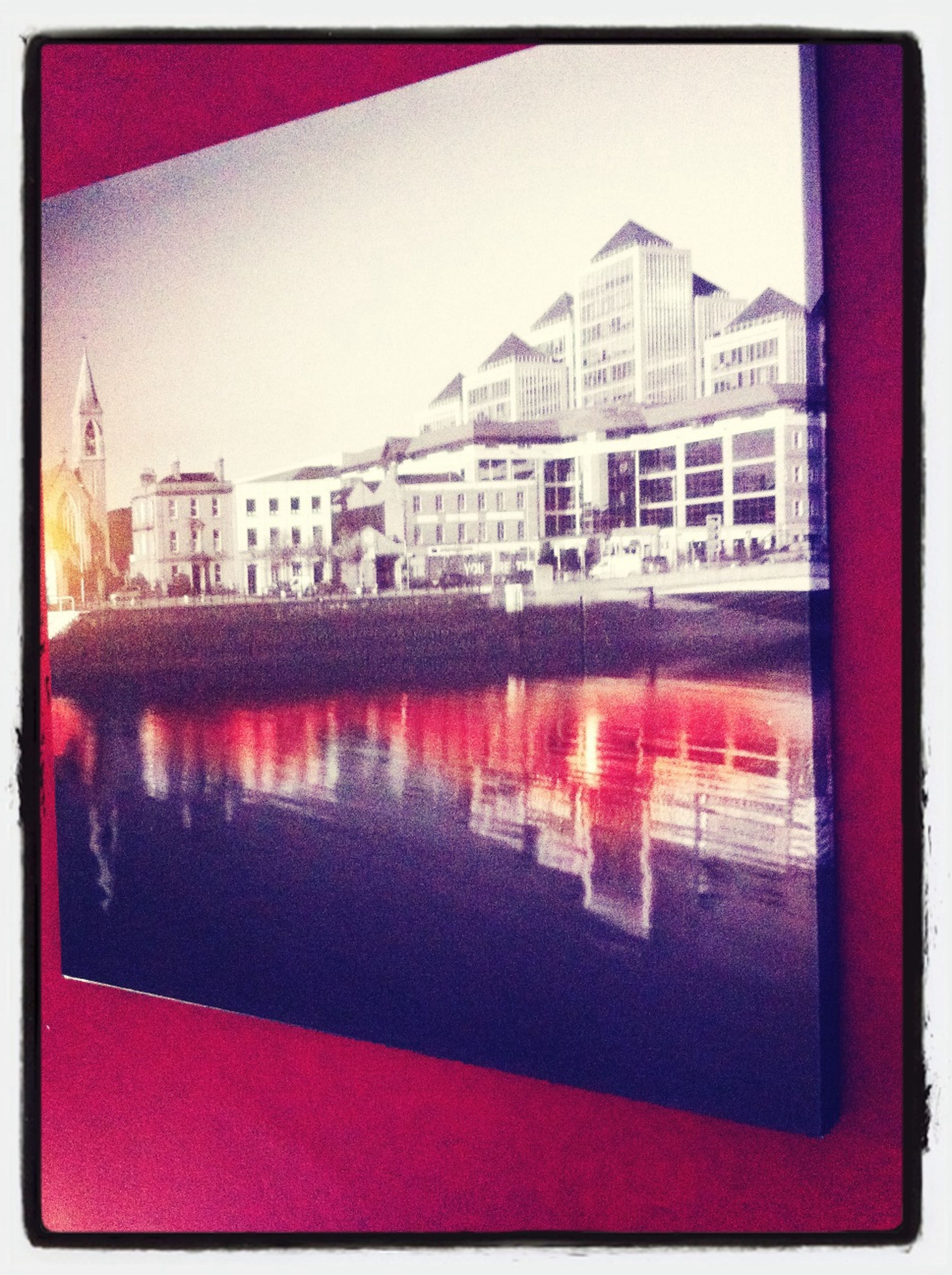 transfer print, indoors, auto post production filter, architecture, built structure, window, red, glass - material, building exterior, high angle view, no people, pink color, close-up, day, reflection, pattern, table, city, transparent, wall - building feature