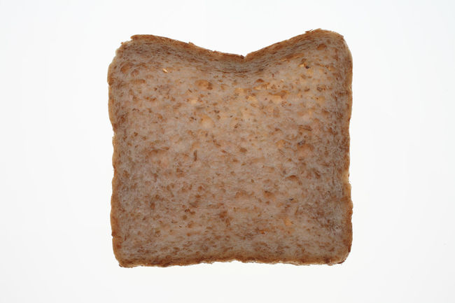 slices of Wholemeal toast bread on white Bread Brown Close-up Creativity Cut Out Directly Above Freshness Geometric Shape Heart Shape Love Making No People Preparation  Romance Slices Stone Studio Shot Temptation Toastbread Toast🍞 Toughness White Background Wholemeal Wholemeal Bread