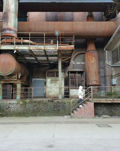 Me Old Buildings Stairs Full Frame Building Exterior Technology Adapted To The City Rusty Faded Steelwork Industry Vintage Facades Factory Steel Built Structure Female Model Thoughtful Pipeline Lines Abandoned Coat Cold Day Winter Bricks Light Colors