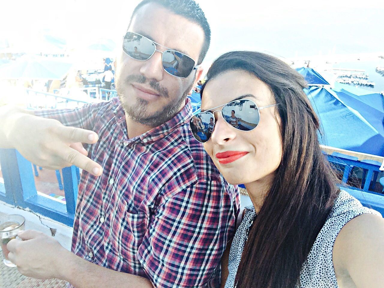 sunglasses, two people, selfie, togetherness, young men, young adult, young women, friendship, portrait, smiling, lifestyles, photographing, looking at camera, men, real people, day, sitting, happiness, outdoors, photography themes, women, close-up, adult, people