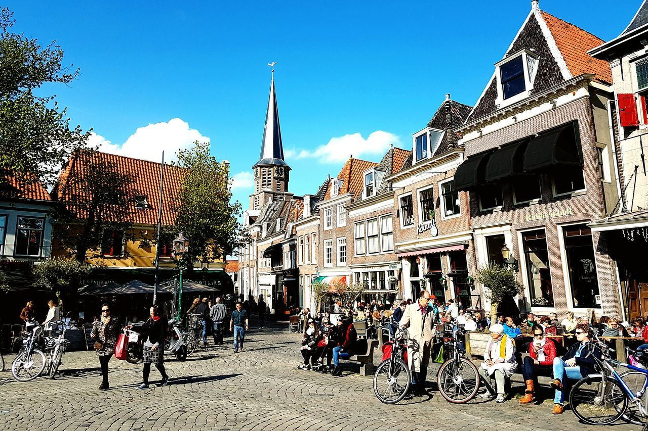 Large Group Of People Travel Destinations Architecture Sky Outdoors Day Building Exterior Tree People Clear Sky Dutch Cities Dutch House Dutch Life Dutch Architecture Holland Holiday Netherlands The Street Photographer - 2017 EyeEm Awards The Street Photographer - 2017 EyeEm Awards The Photojournalist - 2017 EyeEm Awards