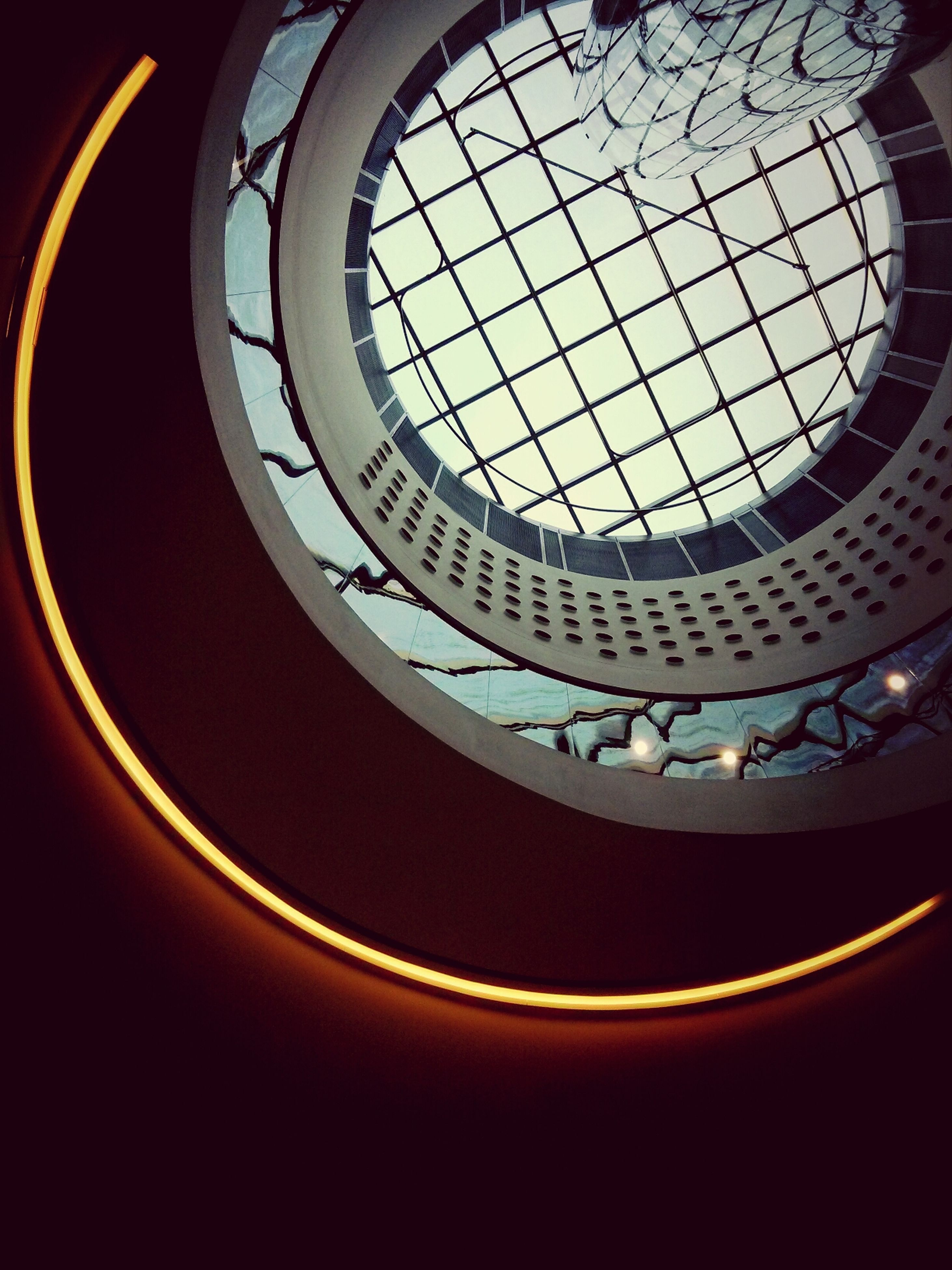 indoors, architecture, built structure, low angle view, circle, geometric shape, skylight, pattern, design, sky, window, ceiling, shape, directly below, spiral, no people, architectural feature, spiral staircase, railing, glass - material