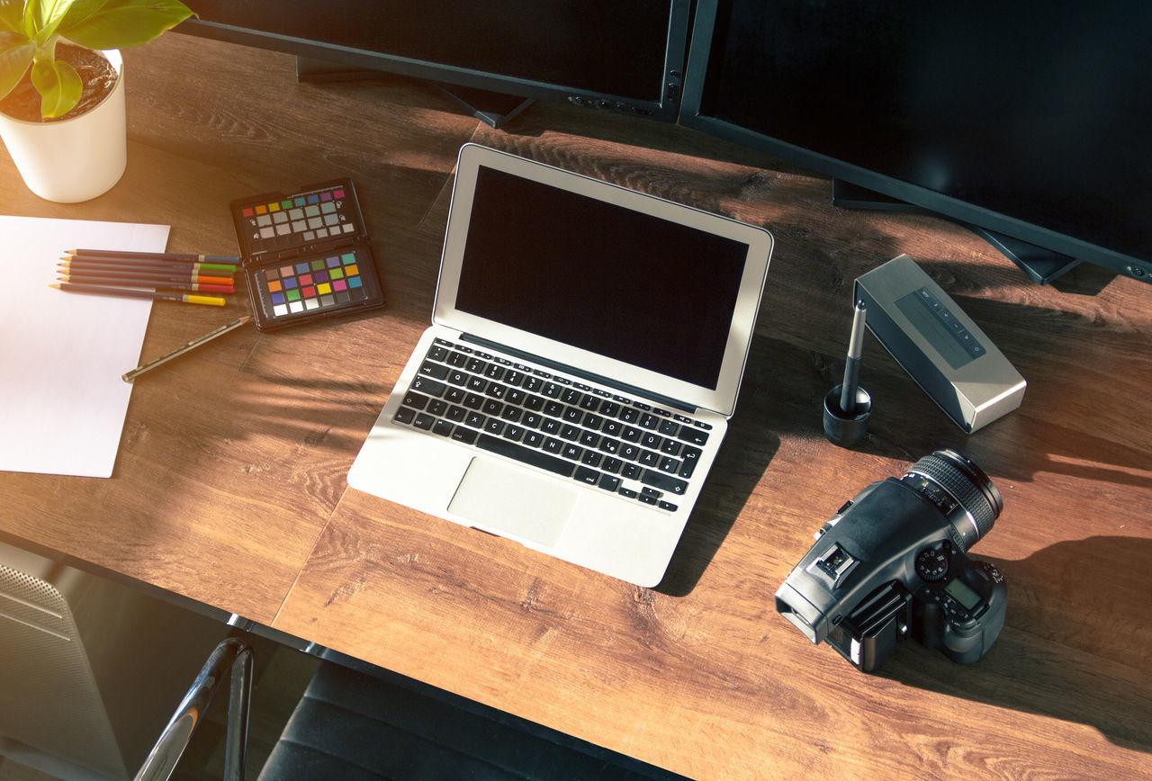 desktop shot of wooden desk with equipment Camera Computer Desks From Above Desktop DesktopBackGround Graphic Design Media Technology Wood Wooden