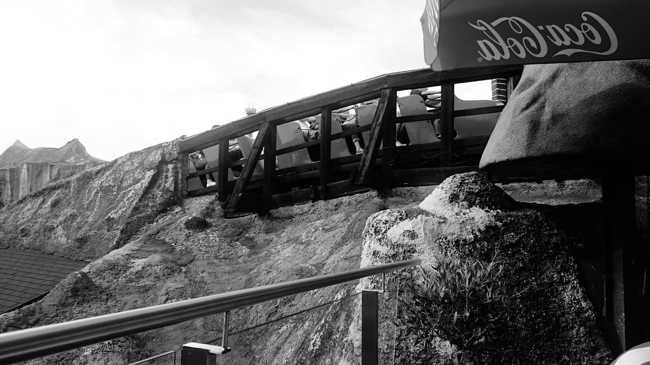 railing, text, day, outdoors, nature, communication, animal themes, bridge - man made structure, sky, mountain, no people, low angle view, one animal, footbridge, mammal, close-up