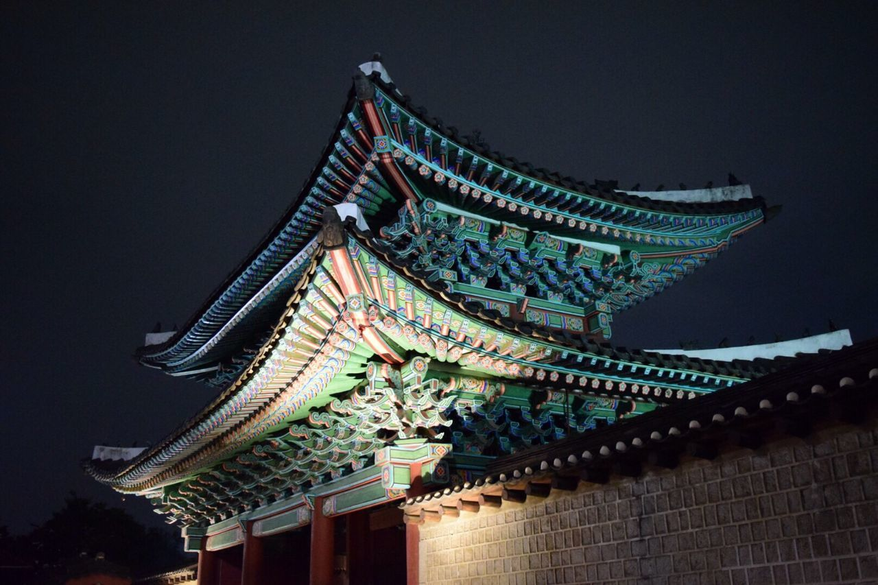 architecture, building exterior, built structure, low angle view, eaves, roof, cultures, traditional building, tradition, religion, place of worship, outdoors, night, no people, travel destinations, illuminated, sky
