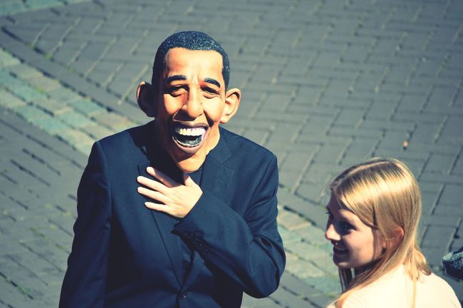 Streetphotography Taking Photos Obama Mask Luxxxs Casual Clothing Fun Hello World People Outdoors Person Portrait Leisure Activity Waist Up Looking At Camera Front View Young Men Lifestyles Young Adult Blue Focus On Foreground Day Handsome Facial Expression Attitude