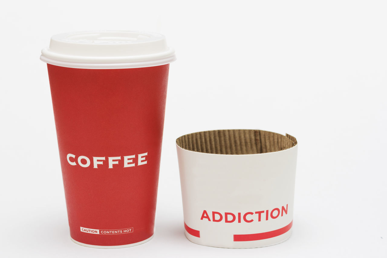 A concept of coffee addiction among people nowadays. Close-up Coffee Time Coffee, Isolated, Take, Away, To, Go, Cup, Paper, Takeaway, Cap, Background, Bar, Beverage, Break, Cafe, Caffeine, Cappuccino, Latte, Mocha, Cardboard, Container, Convenience, Copy, Design, Detail, Disposable, Drink, Energy, Grab, Espresso, Fast, Food, He Hot No People People And Places Studio Shot White Background