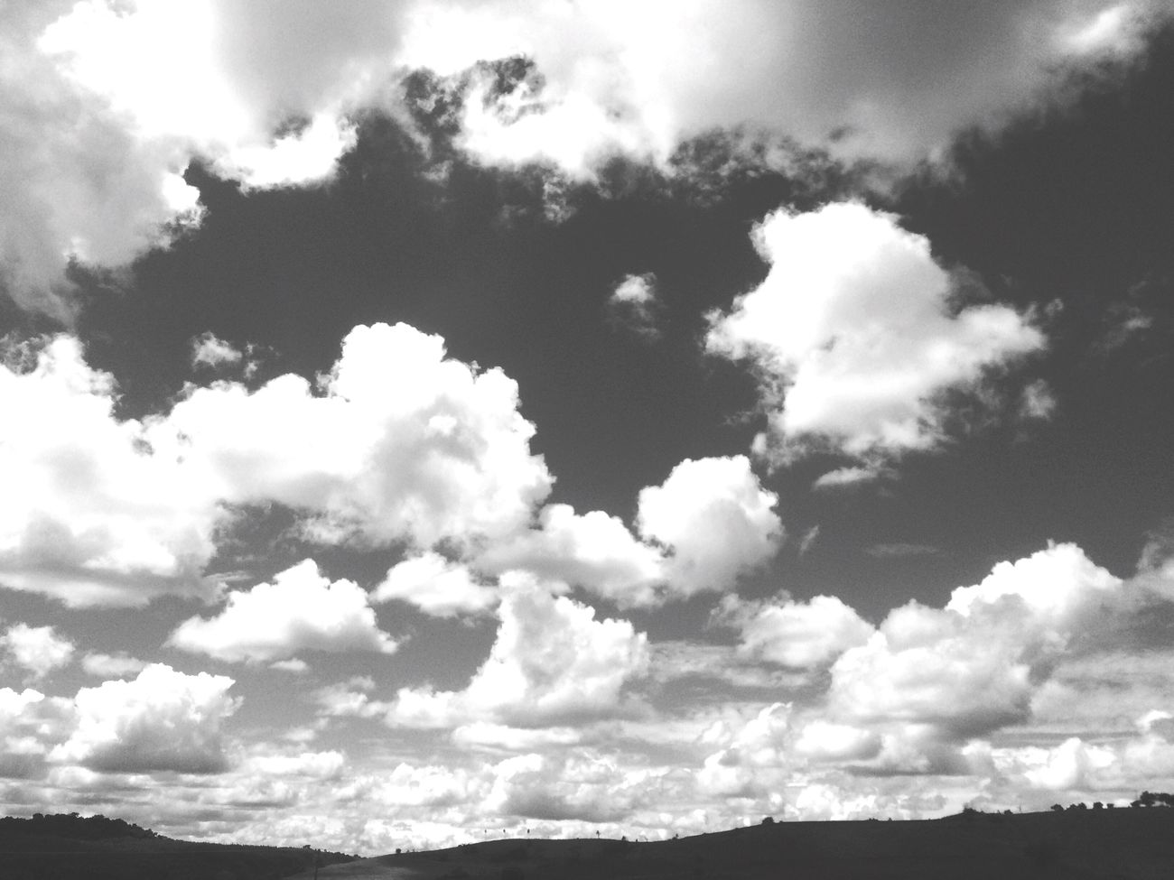 Blackandwhite Beauty In Nature Sky Cloud - Sky Cloudscape Cumulus Cloud Abstract Scenics Fluffy Low Angle View