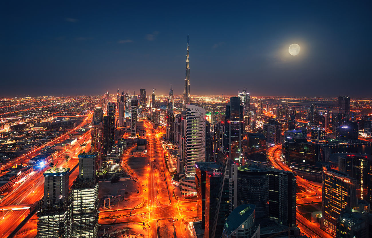 Dubai at night with full moon Arab Architecture Background Beautiful Blue Building Burj Khalifa Business City Downtown Dubai Emirates Light Modern Moon Night Road Road Sky Skyscraper Structure Tallest Tower United Urban Skyline