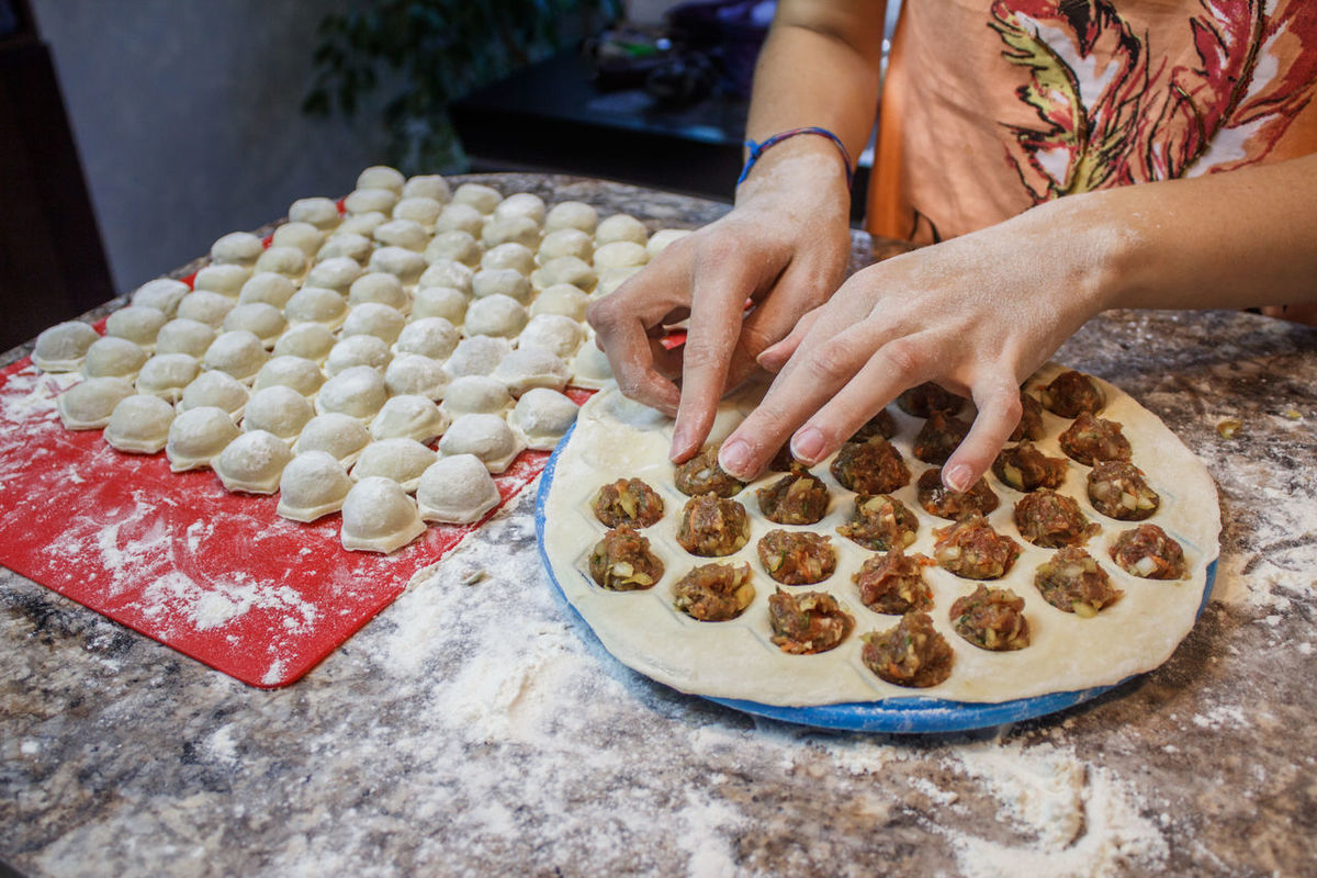 EyeEm Selects Meatballs Meat Dumplings Pelmeni Russian Kitchen Cookie Dough Preparation  Domestic Life Homemade Food And Drink Indoors  Making Food Cooking Cooking At Home Human Hand Kitchen Girl Woman Gourmet People One Person Human Body Part Adult