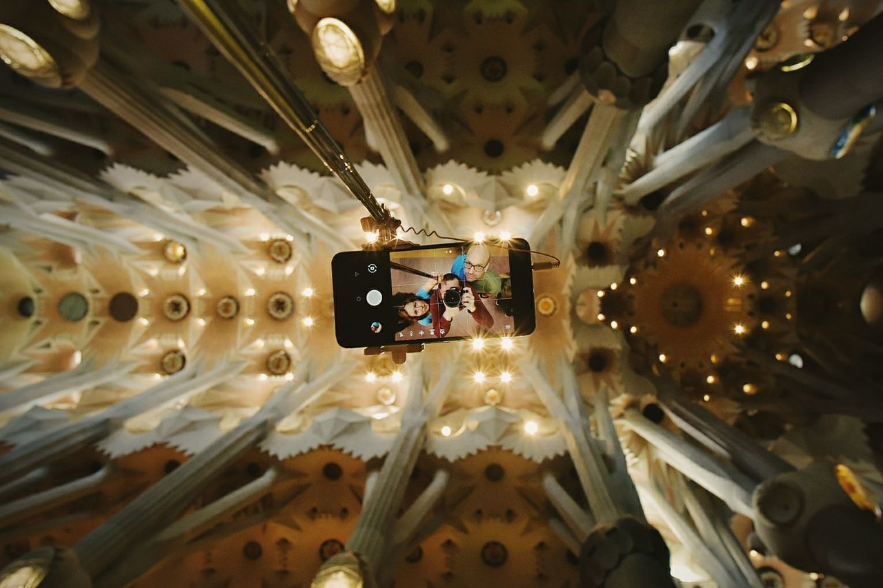 What to do when you can't avoid the tourist masses and try to behave inconspicuous? Get a selfie stick and start the fun. No shame, no glory. Barcelona Cathedral Ceiling Clock Close-up Day Hanging Illuminated Indoors  La Sagrada Familia Lighting Equipment Low Angle View Sagrada Familia Self Portrait Selfie Selfie Stick Smartphone The Photojournalist - 2017 EyeEm Awards The Portraitist - 2017 EyeEm Awards