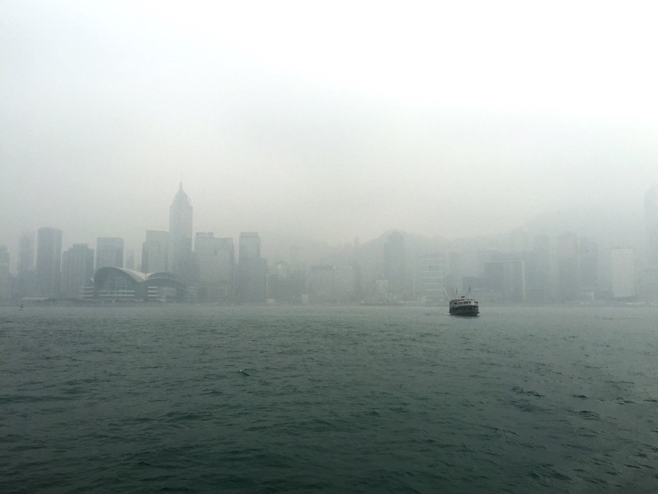 Scenic View Of Sea Against Sky In City During Foggy Weather