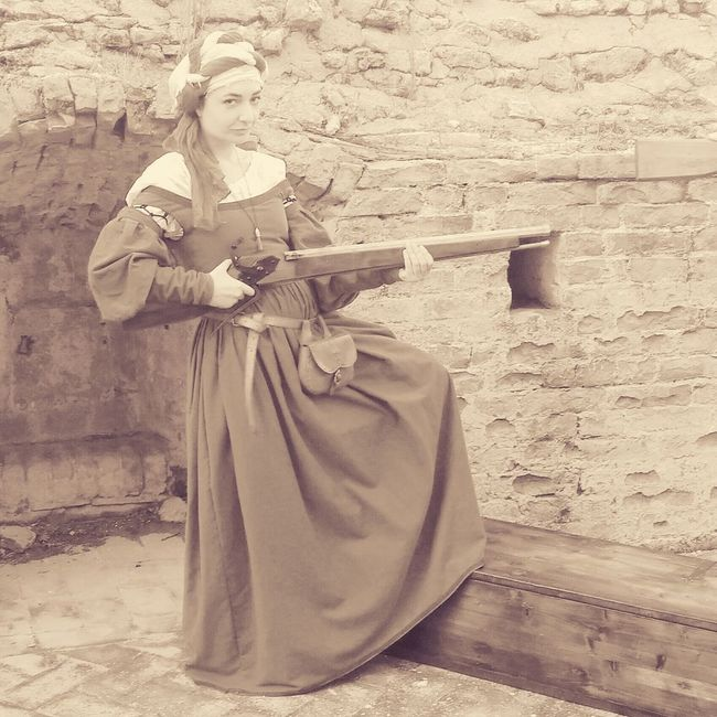 Renaissance One Woman Only Standing Outdoors Old-fashioned Sword Guns Rifle