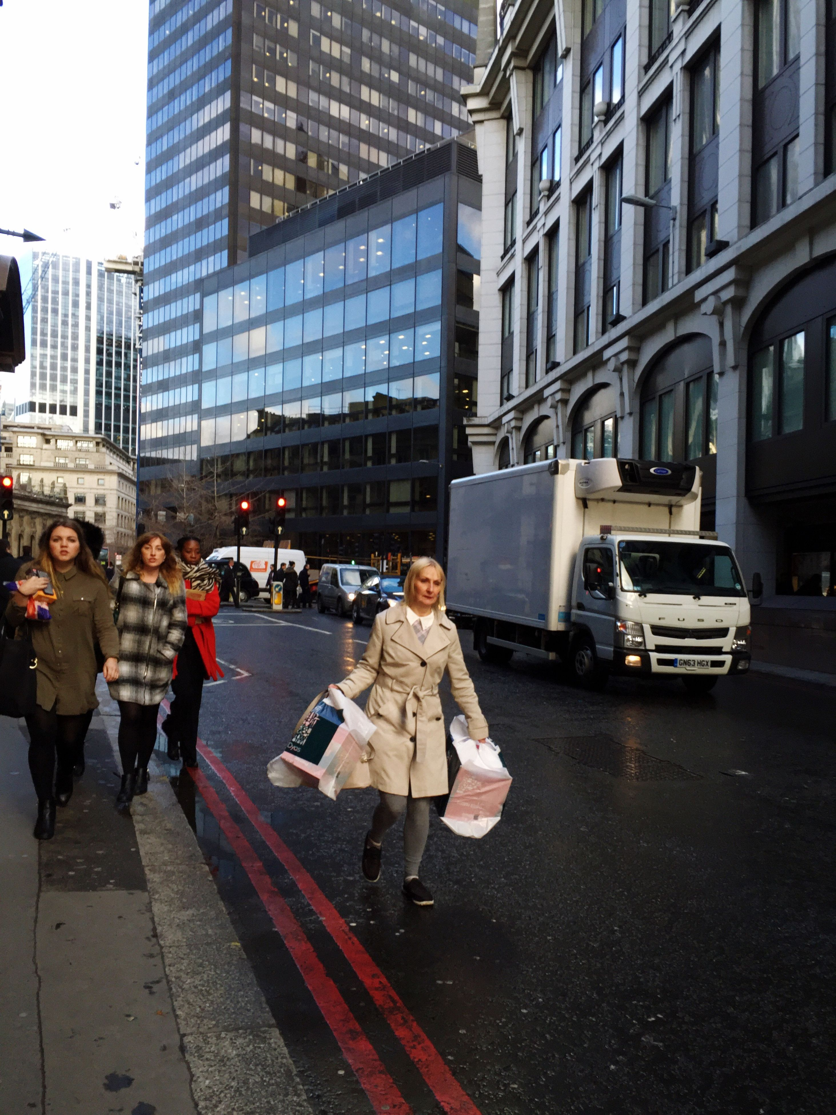 building exterior, city, architecture, street, built structure, city life, men, transportation, lifestyles, walking, car, person, city street, large group of people, land vehicle, road, mode of transport, zebra crossing, leisure activity