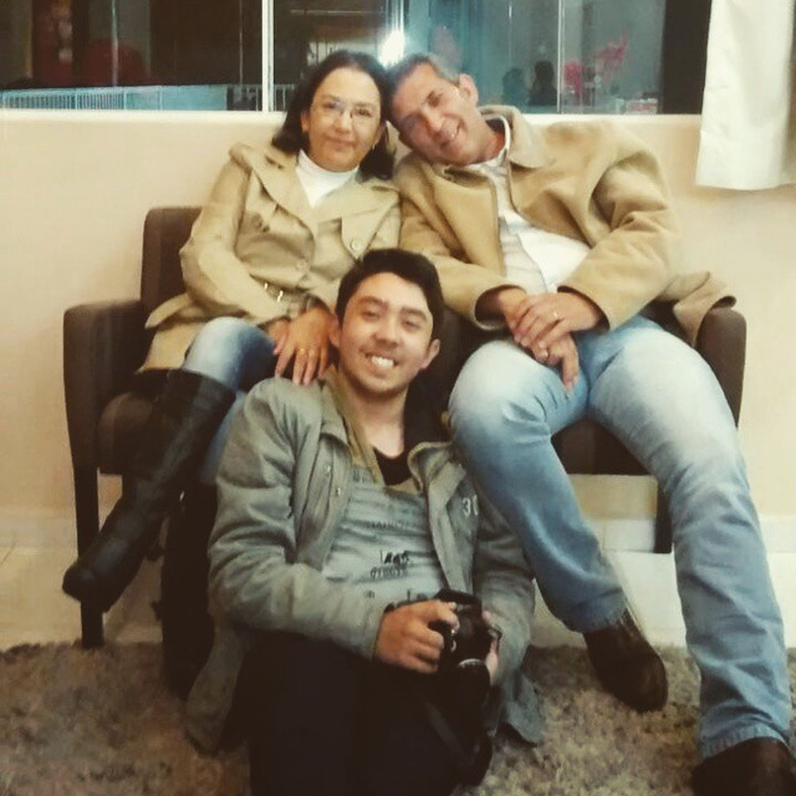 person, portrait, looking at camera, togetherness, lifestyles, smiling, happiness, leisure activity, childhood, casual clothing, bonding, full length, elementary age, sitting, front view, boys, love, young adult