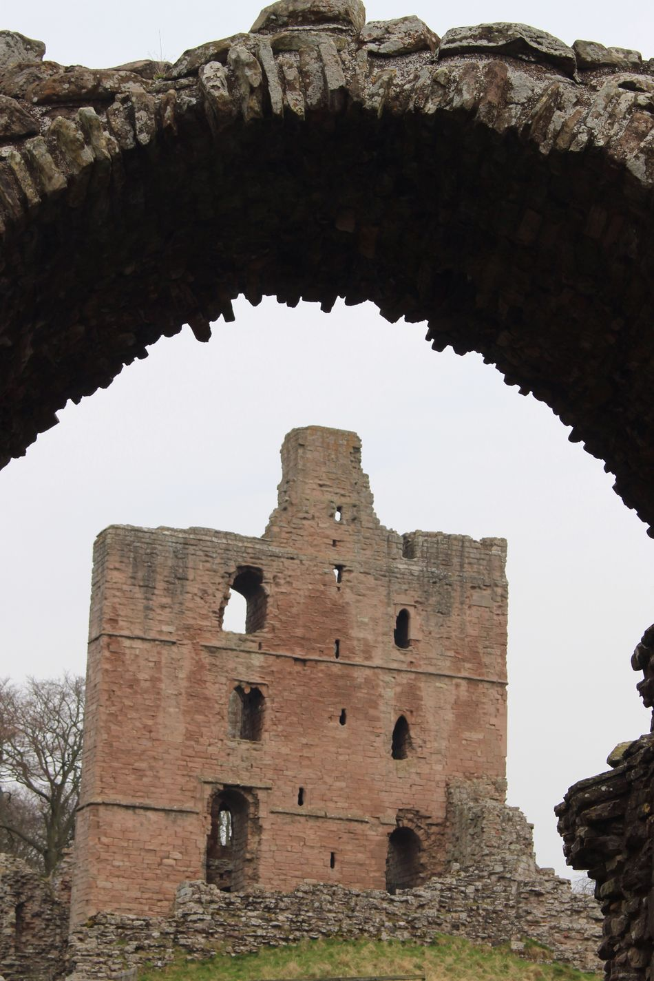 Towering. Architecture Low Angle View Built Structure History The Past Old Ruin Building Exterior Arch Day Castle No People Sky Outdoors Ancient Civilization Northumberland Norham Castle Architecture Looking Through