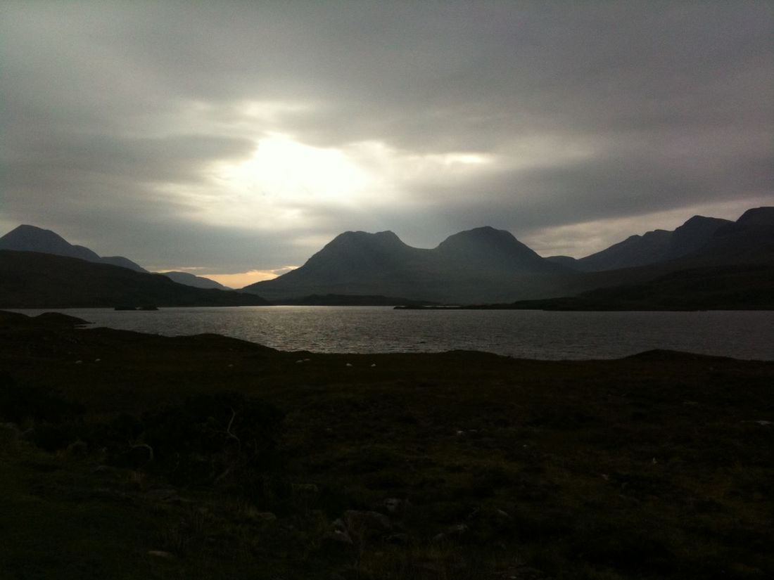 Sun across the mountains and loch in Scotland Loch  Scotland Beauty In Nature Landscape Mountain Mountain Range Nature No People Outdoors Scenery Scenics Sky Tranquil Scene Tranquility Water Wilderness