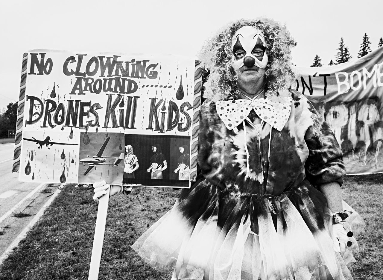Clown displaying sign. At No More Drones rally. Protest Campripley Minneapolis Minnesota Clown Drones Syrian War First Eyeem Photo Fine Art Photography