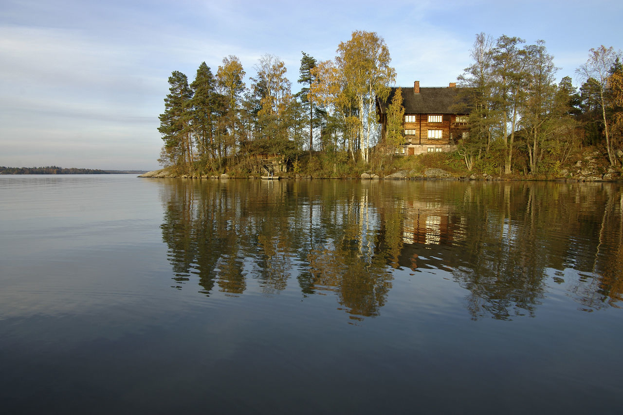 A Golden Era Of Finnisch Art A Quiet Evening By A Lake A Traditional Log House By A Lake Day Halosenniemi Galleria, Finland Nature No People Outdoors Reflection Reflection Lake Sky Tree Water