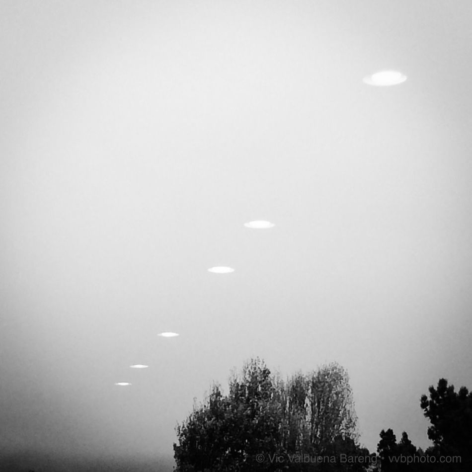A parade of UFOs spotted above So.San Francisco, CA 2014. UFOhoax Blackandwhite Streetphotography IPhoneography