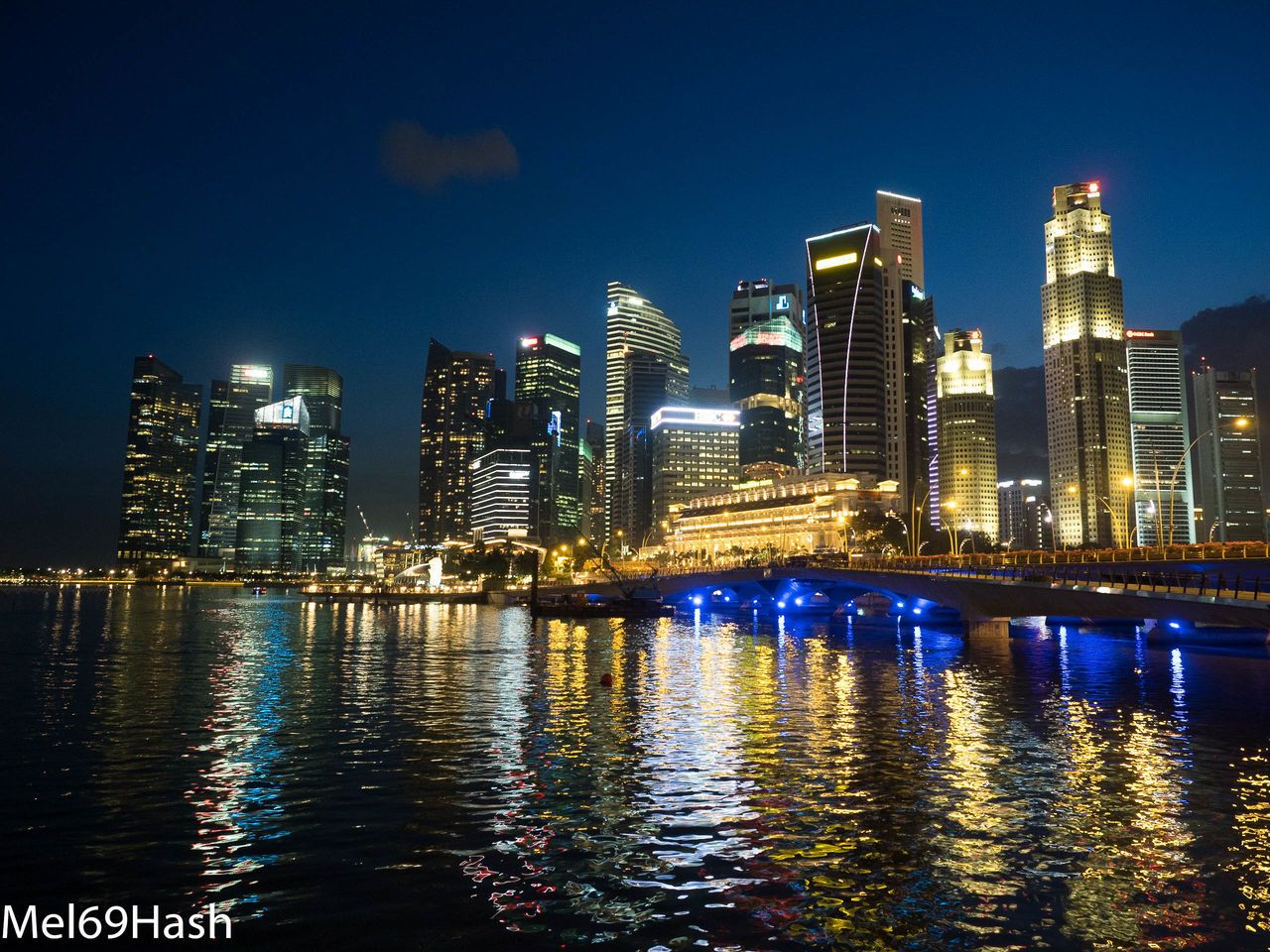 night, illuminated, building exterior, architecture, waterfront, skyscraper, reflection, city, water, built structure, cityscape, river, urban skyline, travel destinations, outdoors, modern, sky, no people, blue