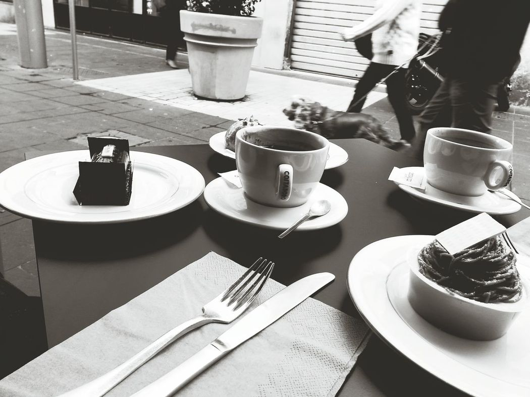 sweet moment Coffee - Drink Coffee Cup Saucer Food And Drink Adults Only Drink People Adult Human Body Part Human Hand One Person Freshness Day Cafés Nice / Nizza Sweets Chocolate Chocolate♡ Maron Nougat Street Photography Street Life EyeEmNewHere Black And White Food The Street Photographer - 2017 EyeEm Awards Live For The Story Black And White Friday