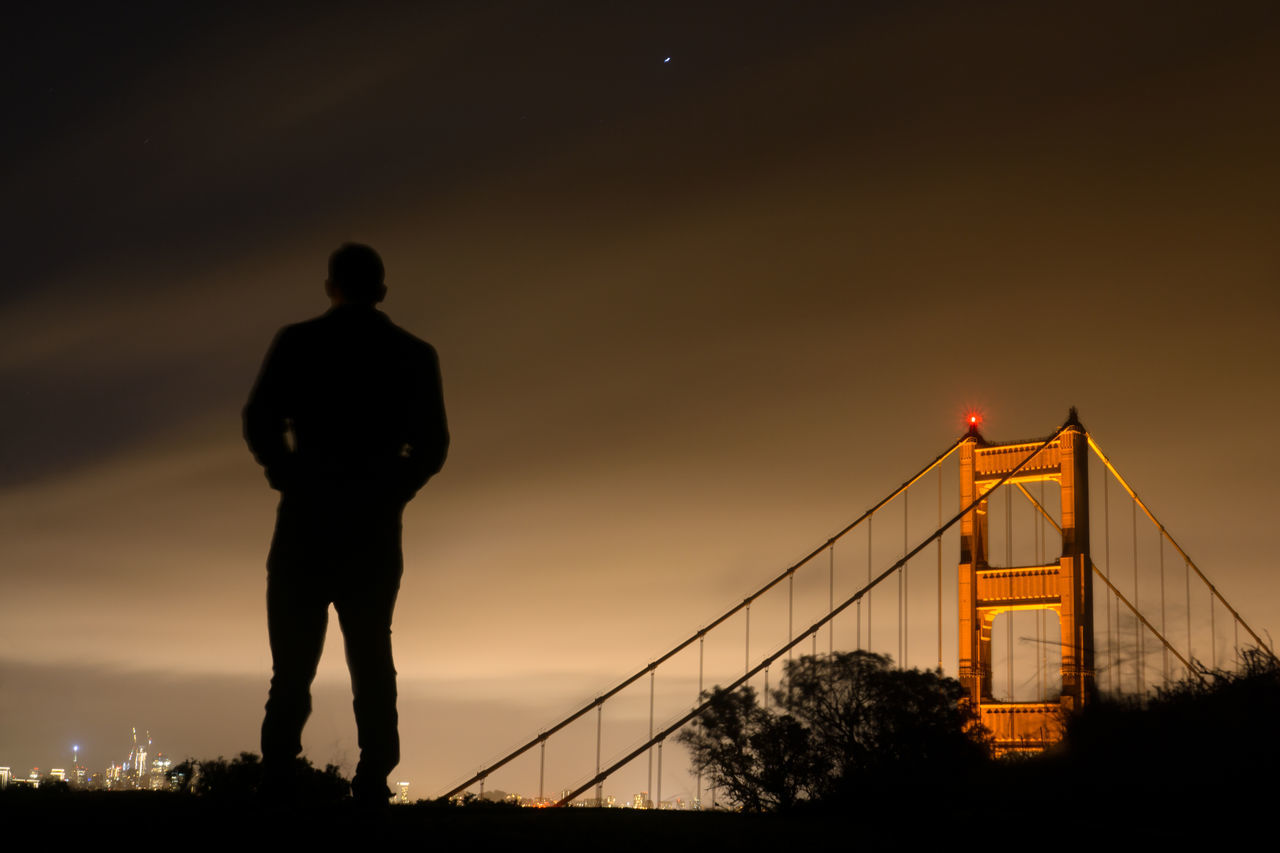 Adult Bridge - Man Made Structure City Cityscape Connection Fog Foggy Golden Gate Bridge Human Body Part Human Hand Landmark Landscape Low Angle View One Person Outdoor Outdoors People San Francisco Scale  Silhouette Sky Standing Sunset Suspension Bridge