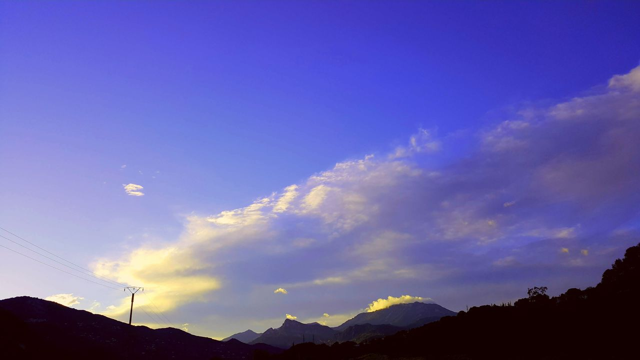silhouette, sky, nature, blue, scenics, beauty in nature, mountain, no people, cloud - sky, sunset, low angle view, outdoors, day