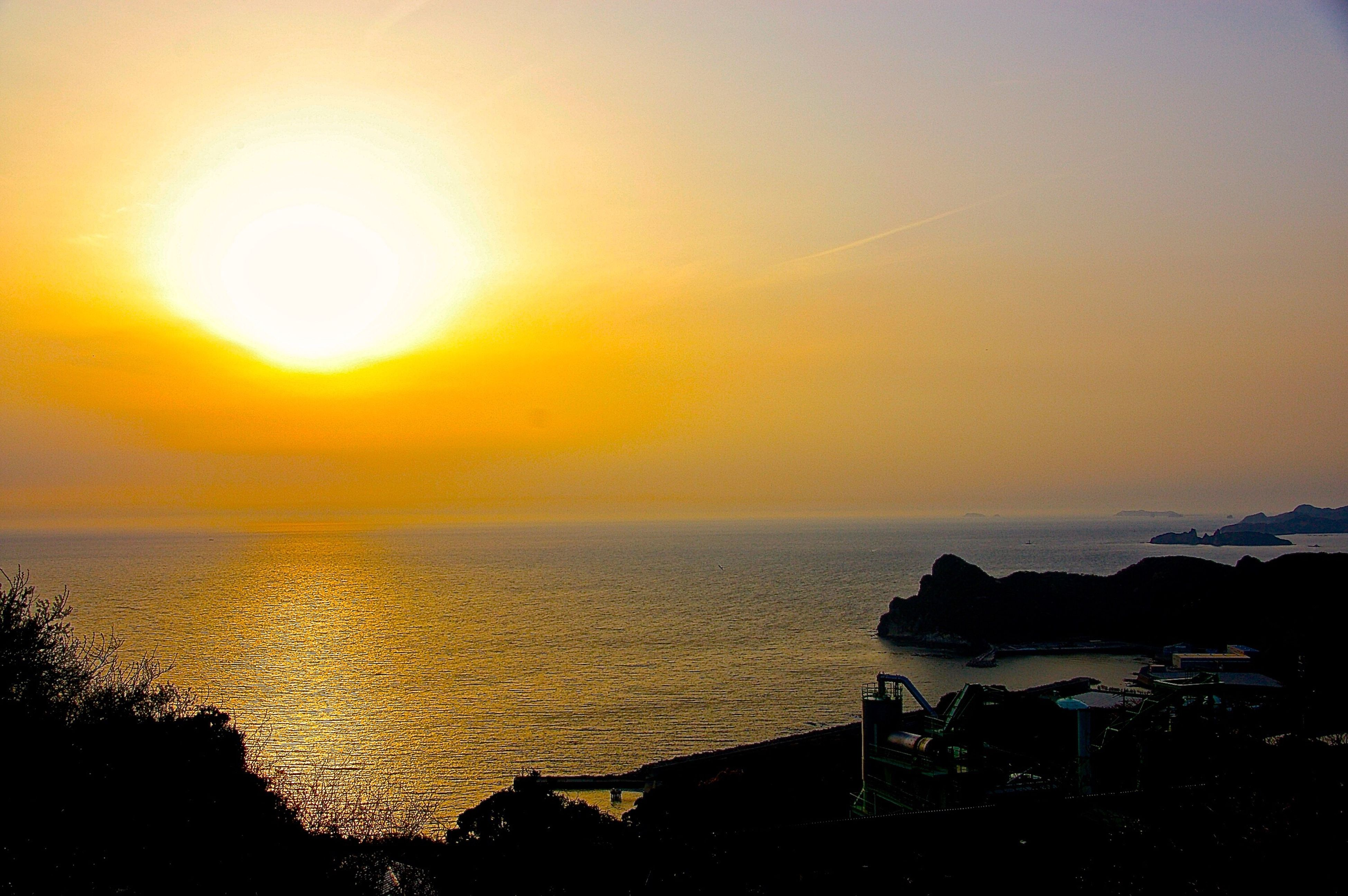sunset, sun, sea, horizon over water, water, scenics, tranquil scene, orange color, beauty in nature, tranquility, sky, idyllic, nature, shore, sunlight, lens flare, sunbeam, outdoors, remote, no people, coastline, non-urban scene, bright, ocean, landscape