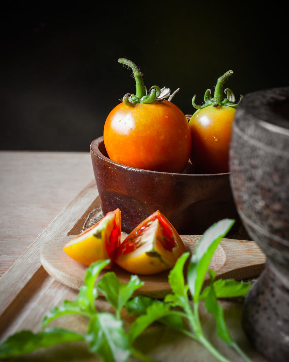 Agriculture Asian Food Basil Bio Food Close-up Culture Food Food And Drink Food Stylist Freshness Fruit Healthy Eating Indoors  Ladle Mortar No People Plant Raw Food Ready-to-eat SLICE Studio Shot Tomato Traditional Vegetable Wood - Material