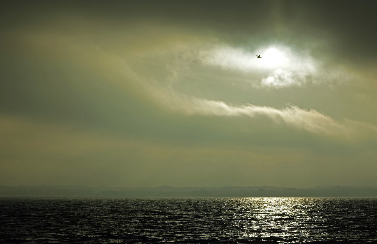 scenics, nature, sky, sea, beauty in nature, sunset, tranquil scene, outdoors, tranquility, horizon over water, silhouette, sun, water, sunlight, waterfront, cloud - sky, no people, day
