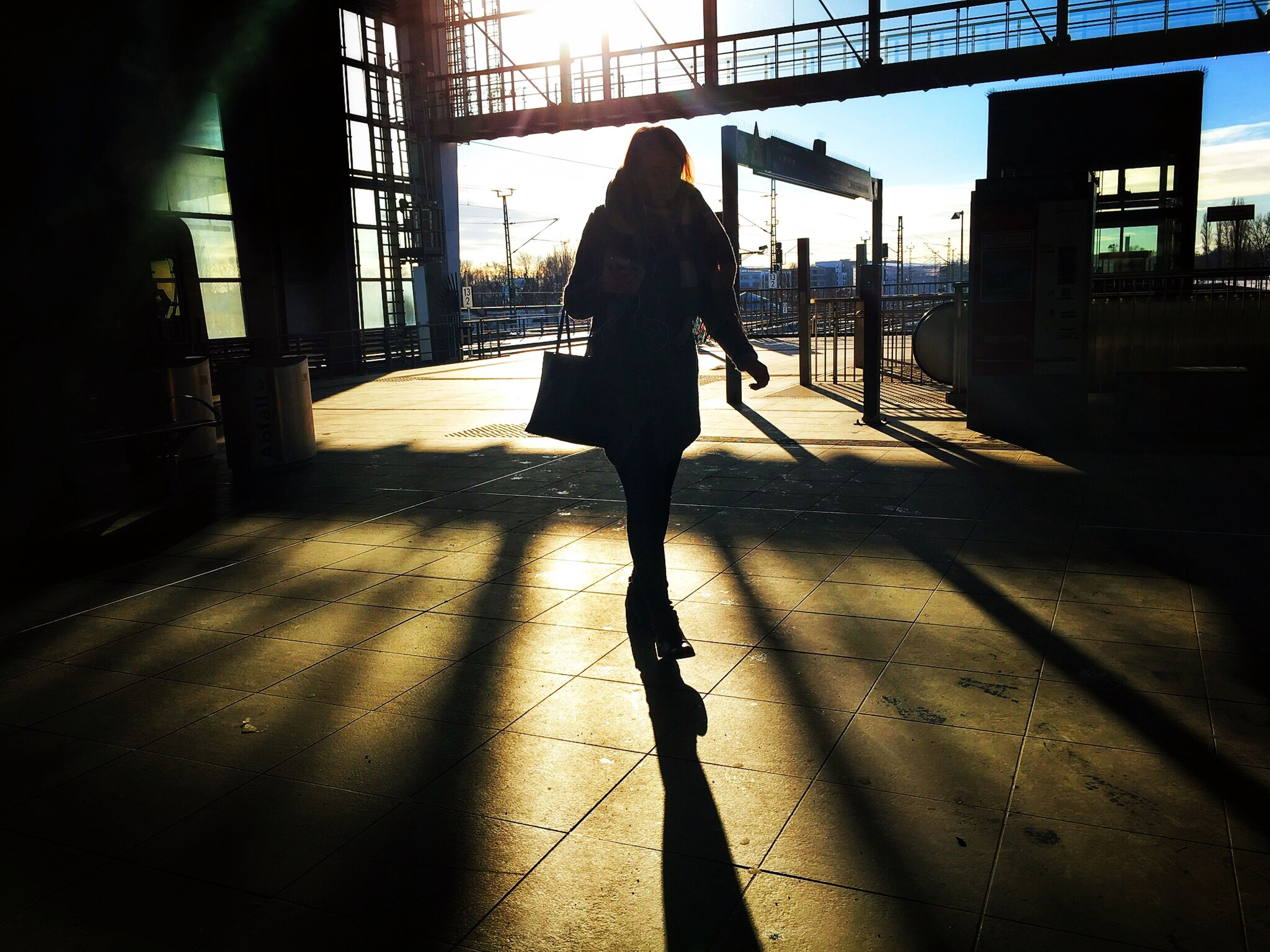 full length, real people, walking, one person, sunlight, shadow, rear view, silhouette, day, adults only, men, people, outdoors, sky, adult, one man only, only men