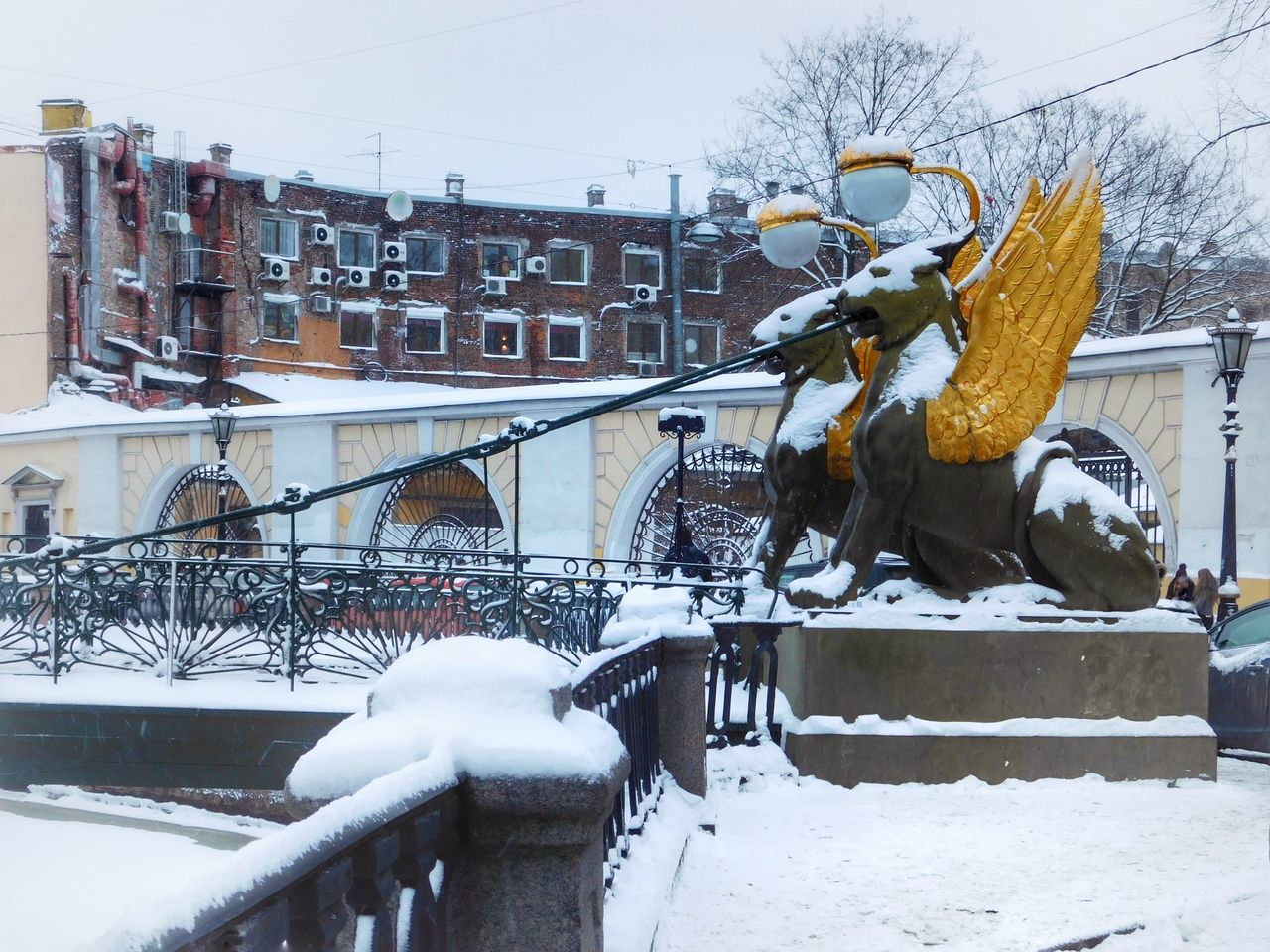 Animal Representation Animal Themes Architecture Bridge Bridge Over Water Building Exterior Built Structure City Cold Temperature Day Ice Iced Lion Modern Outdoors Snow Snow Covered Snowing Statue Winter