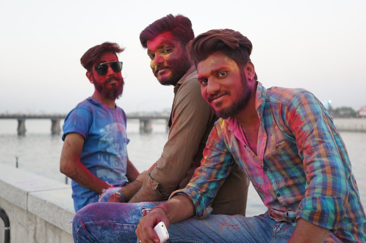 Holi in Ahmedabad, India Only Men Adults Only Sitting Happiness Togetherness Couple Celebration Adult Young Adult Sunset Smiling Friendship Men Sky People Outdoors Real People Community Cultures Holi Millennial Pink