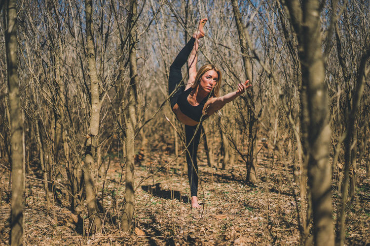 lord of the dance. Bare Tree Beauty Casual Clothing Confidence  Day Front View Full Length Leisure Activity Lifestyles Looking At Camera Mature Adult Nature Non-urban Scene Outdoors Person Standing Tree Tree Trunk WoodLand Yoga Young Adult Young Women