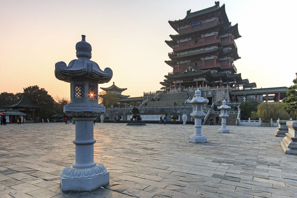 Nanchang, China - December 30, 2015: Tengwang Pavilion in Nanchang at sunset, one of the four famous towers in south China Architectural Column Architecture Art ASIA Built Structure Capital Cities  China Chinese New Year City Famous Place History Jianxi Metropolis Modern Building Monument Nanchang Outdoors Pagoda Pavilion On Lake Province Sky Temple - Building Tengwang Tourism Travel Destinations