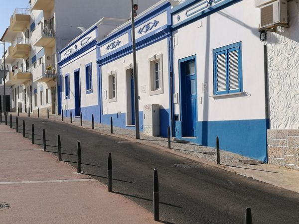 Evening in Albufeira.... Architecture Building Exterior Day Outdoors No People Focus On Foreground Historical Building Built Structure Wall Paint Blue And White Sky Albufeira Portugal Been There. Done That.