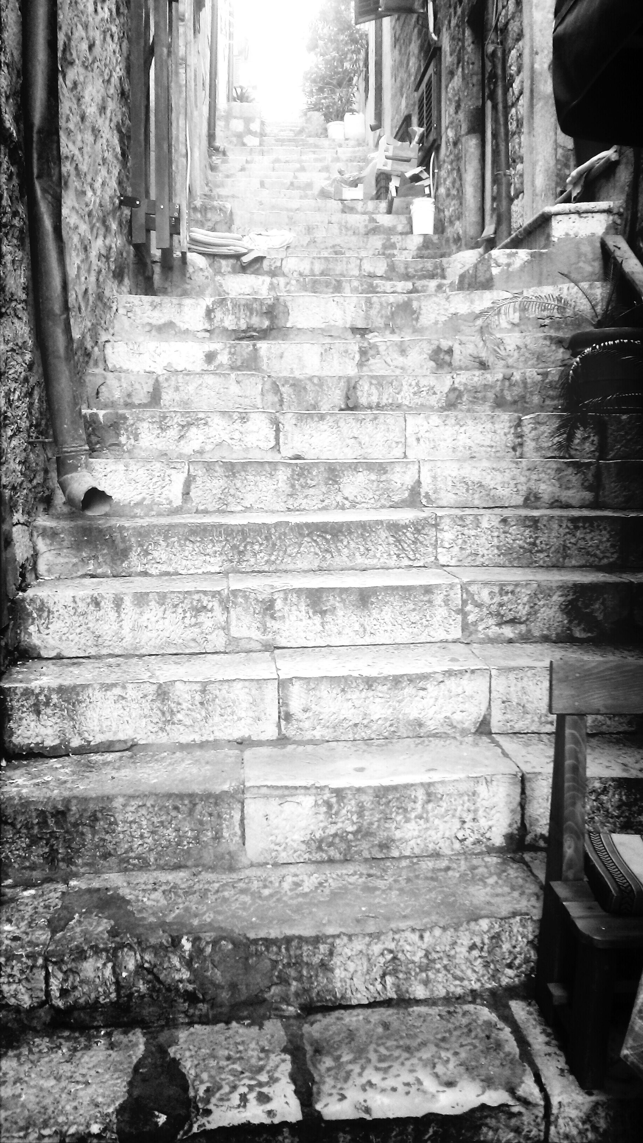 built structure, steps, architecture, building exterior, the way forward, old, stone material, cobblestone, day, outdoors, steps and staircases, footpath, house, abandoned, sunlight, bench, wood - material, paving stone, wall - building feature, stone wall