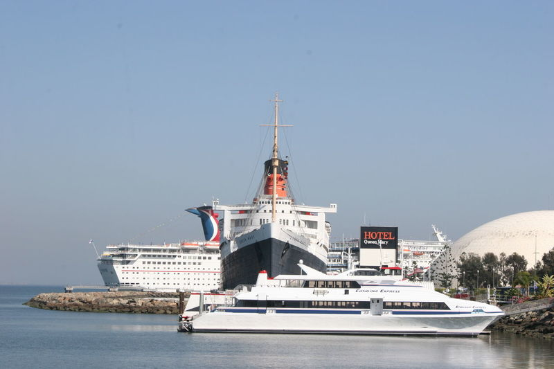Catalina Express, RMS Queen Mary Hotel and Museum and Cruise Ship Cruise Ship Long Beach Harbor Queen Mary Queen Mary Ship Queen Mary In Long Beach California RMS Queen Mary Catalina Express Cruise Ship Docking Day Nautical Vessel No People Outdoors Sky Transportation