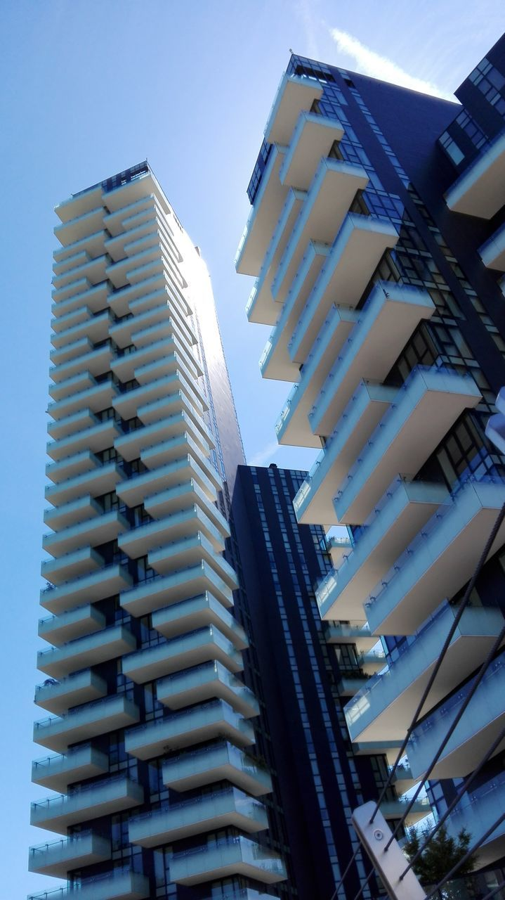 architecture, building exterior, low angle view, built structure, day, outdoors, no people, city, modern, skyscraper, clear sky, sky