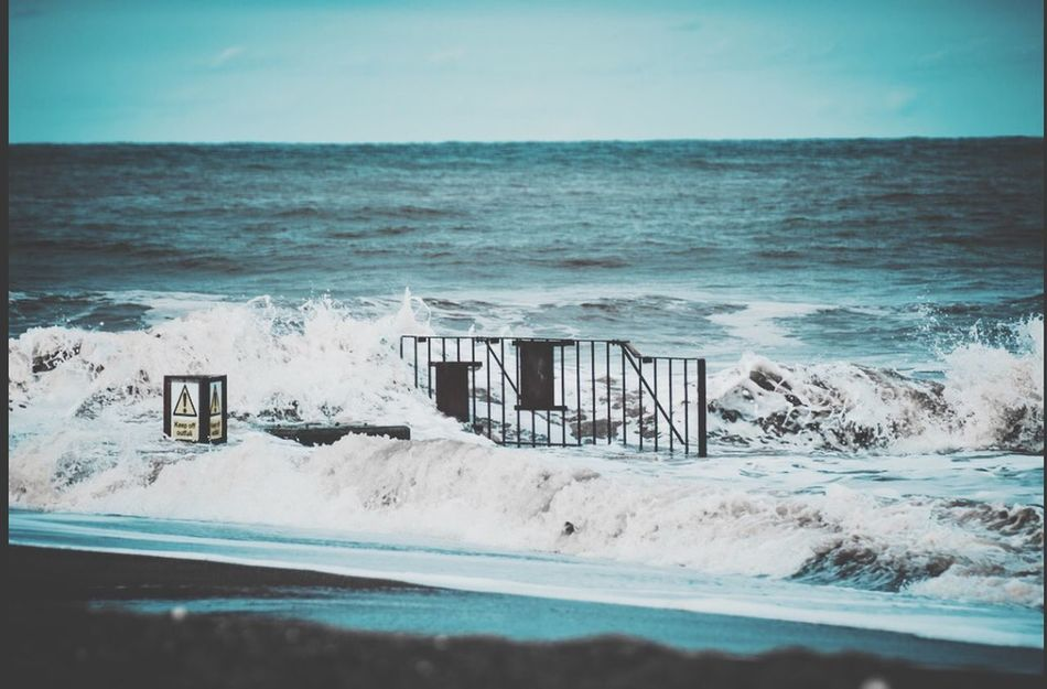 Gate in the middle of the sea. UK , Lincolnshire, Seaside