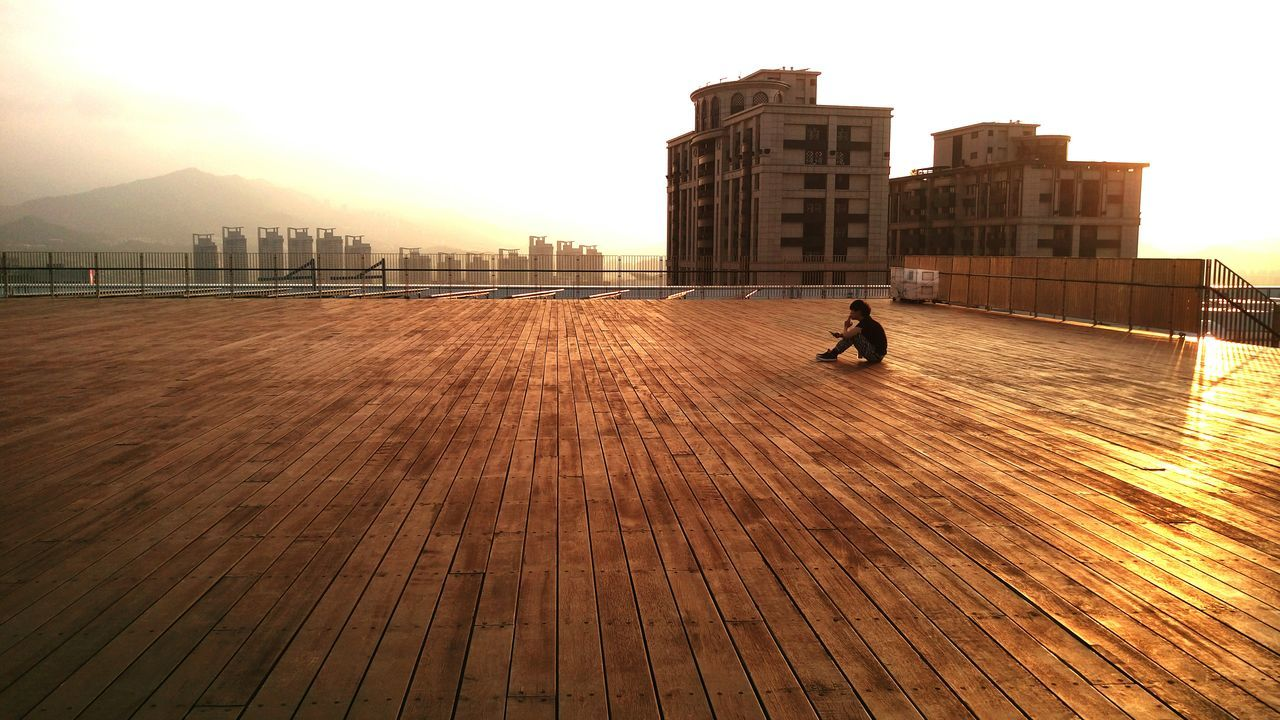 Enjoying The View The Human Condition Capturing Freedom Sunlight RooftopGolden Moment Sunset FreeTime On A Break Getting Inspired