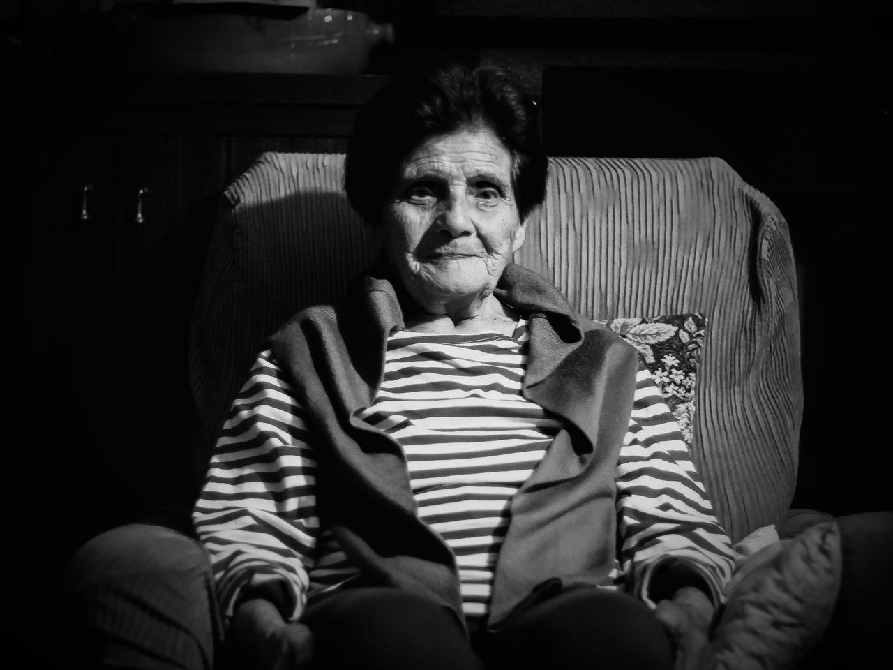 Sitting One Person Striped Front View Portrait Indoors  Looking At Camera Casual Clothing Adult People Lifestyles Real People Relaxation Black Background Smiling The Portraitist - 2017 EyeEm Awards Old Lady Woman Old Woman