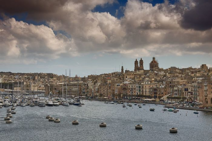 Malta: Grand Harbour and The Three Cities Malta Grand Harbour Harbor Marina Sea Mediterranean  Water Waterfront Boat Ship Moored Mast Urban Skyline Urban City Cityscape Cloud - Sky Skyline No People Architecture Nautical Vessel Travel Destinations Nature Outdoors Building Exterior