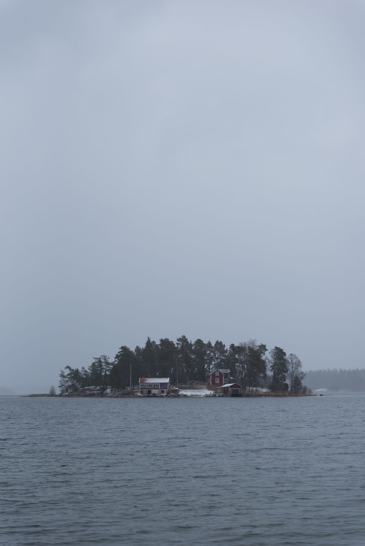 A cloudy day in the Stockholm archipelage. Snow on the ground, but the water is open. Architecture Beauty In Nature Building Exterior Built Structure Clear Sky Day House Nature No People Outdoors Scenics Sea Sky Tranquil Scene Tranquility Tree View Into Land Water Waterfront
