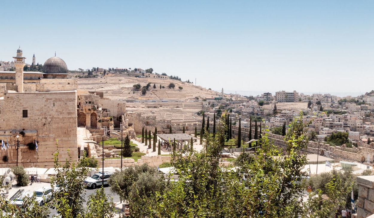 Jerusalem, Israel, July 14, 2017 : View of the Mount of Olives Jerusalem Cemetery from the Dung Gate in the old town in Jerusalem, Israel Al-Aqsa Mosque Ancient Architecture Country Dung Gate El-Ghawanima Tower Israel, Holiday, Sky, Filter, Trees, Birds Jerusalem Cemetery Middle East Wall Arab Architecture Built Structure Culture Day Dome History Holy Jerusalem Judaism Mount Of Olives Muslim Old Religion Temple Mount